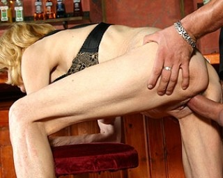 This mature slut gives head and fucks in a bar